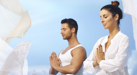 Men and woman in yoga seesion to calm the mind